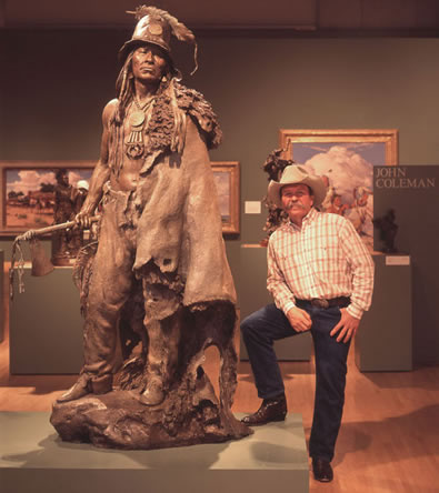 John Coleman with his sculpture, Explorer Artists Bodmer-Catlin Series: Addih-Hiddisch, Hidatsa Chief, Bronze Edition of 9, Available for sale at Mark Sublette Medicine Man Gallery