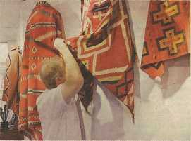 Dr. Mark Sublette examines a Navajo blanket