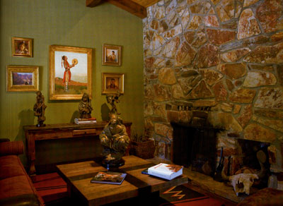 A painting by fellow CAA member John Moyers (center) highlights one of the rooms in Coleman's spacious studio.