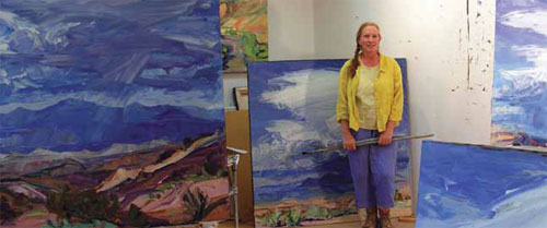Louisa McElwain surrounded by clouds in her studio.