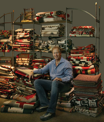 Dr. Mark Sublette, owner of Medicine Man Gallery, in the textile room at his gallery's Tucson, Arizona location. Photo by Meghann Eppstein