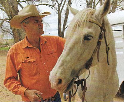 Billy Schenck, the artist saddles up his horse, Badger