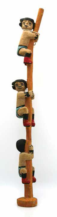 "Hopi Chukus kachina, ca. 1920, 21 x 21⁄2 x 2""."