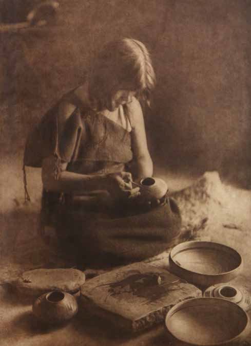 "Edward S. Curtis (1868-1952), The Potter, plate 426, ca. 1906, photogravure on Japanese vellum, 173⁄4 x 13"". Photograph shows Nampeyo Old Lady of Hano."