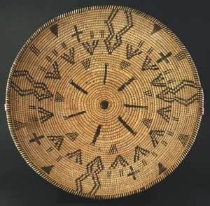 Apache pictorial tray, circa 1890-1900, 14 inches in diameter.