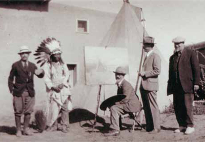 Sharp set up his old Crow teepee outside the Taos studo. Little Egypt is on the right. Note that the painting is of a Montana teepee scene. Left to right are Bert Phillips, Soaring Eagle, Sharp, Ernest Blumenschein and E.I. Couse. PHOTO COURTESY BUFFALO BILL HISTORICAL CENTER, CODY, WY