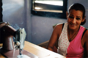 "Ned Sublette, Woman at Sewing Machine, Mariano, Color Photograph, 16"" x 20"""