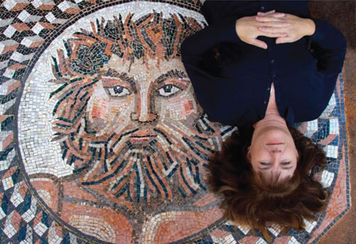 Anne Ziemienski reclines on Jupiter, mosaic home entry art